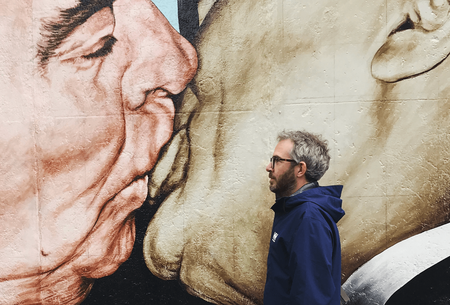 Simon Collison by the Berlin Wall