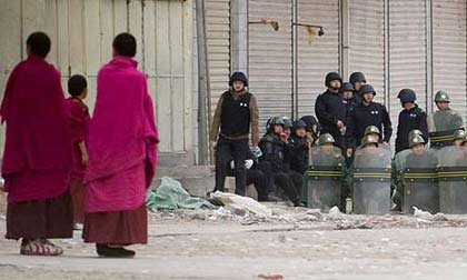 Buddhist Monks in a stand off with security forces in the monastary town of Xiahe, Gansu province, China. Photograph: Dan Chung